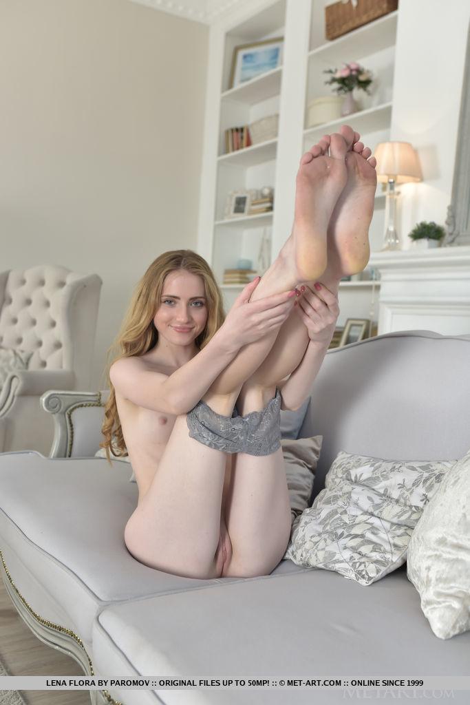 Lena Flora bares her petite, creamy body as she strips on the sofa.