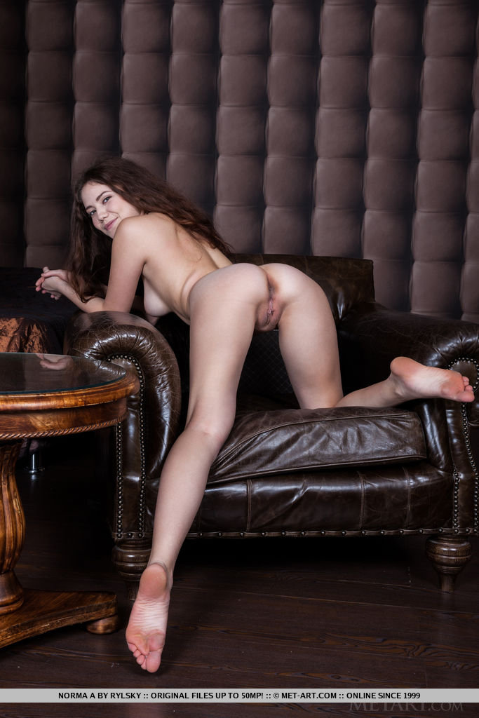 Norma A s long and curly mane framing a natural, sultry beauty with exotic facial features, her long, attractive legs supporting a stunning, shapely body.