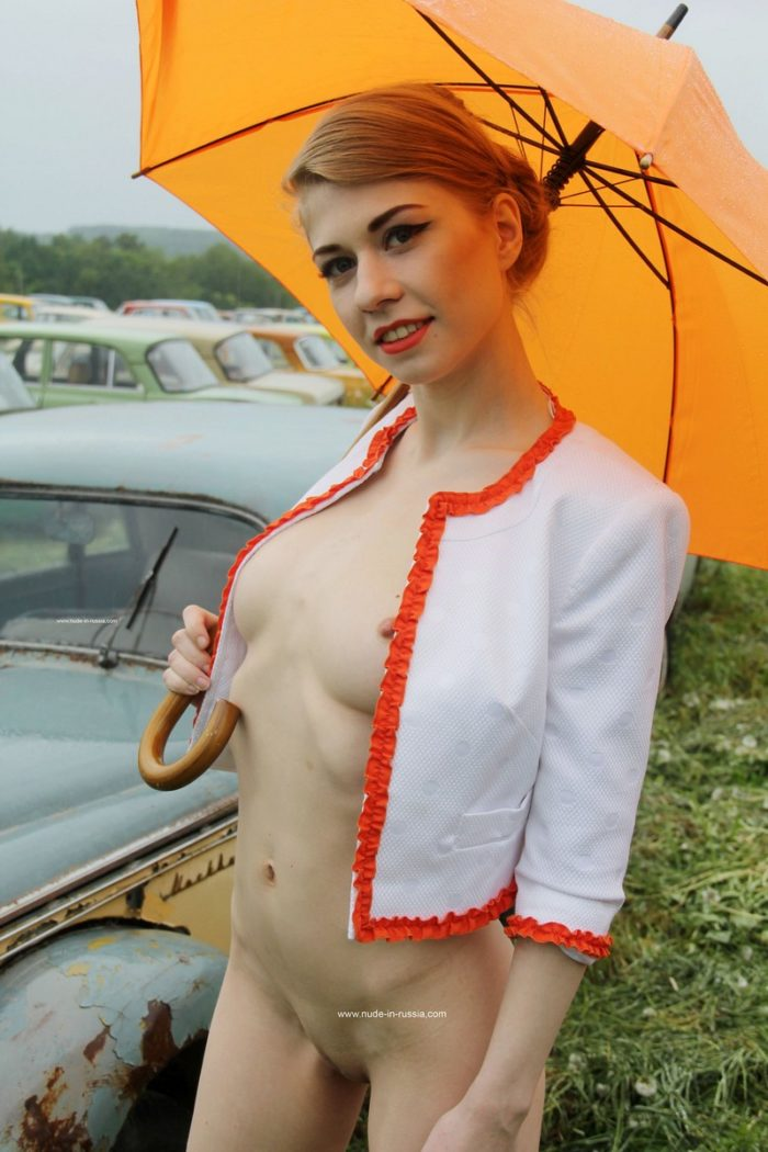 Russian babe Eva Gold at retro cars museum