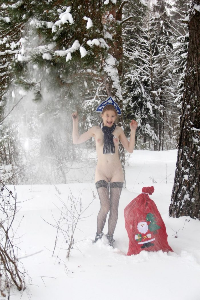 Russian blonde Seshat at snowy forest