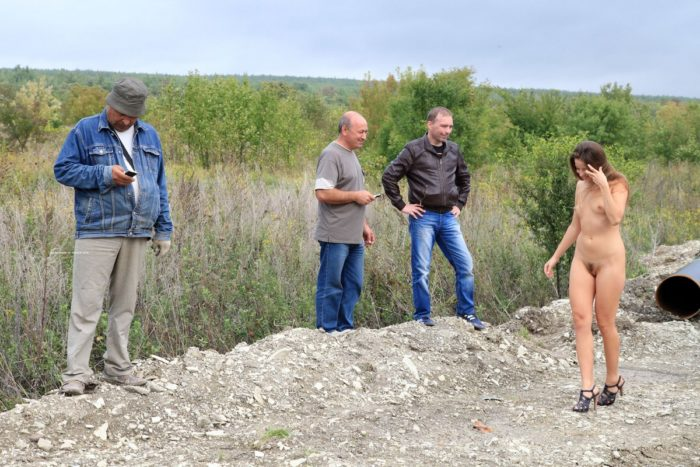 Russian teen Taissia A posing naked with workers
