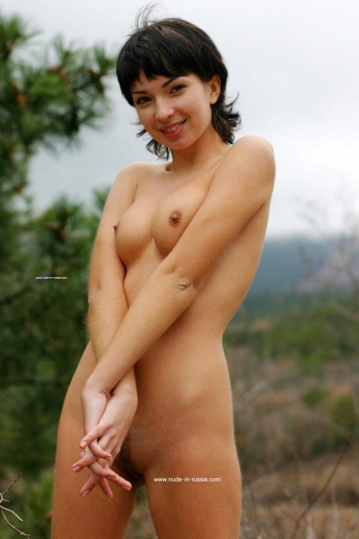 Short-haired brunette Miroslava posing outdoors