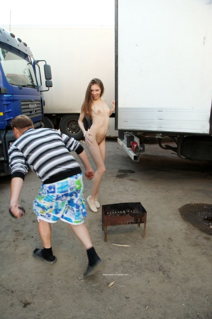Skinny russian girl Viviann takes off clothes at truck parking