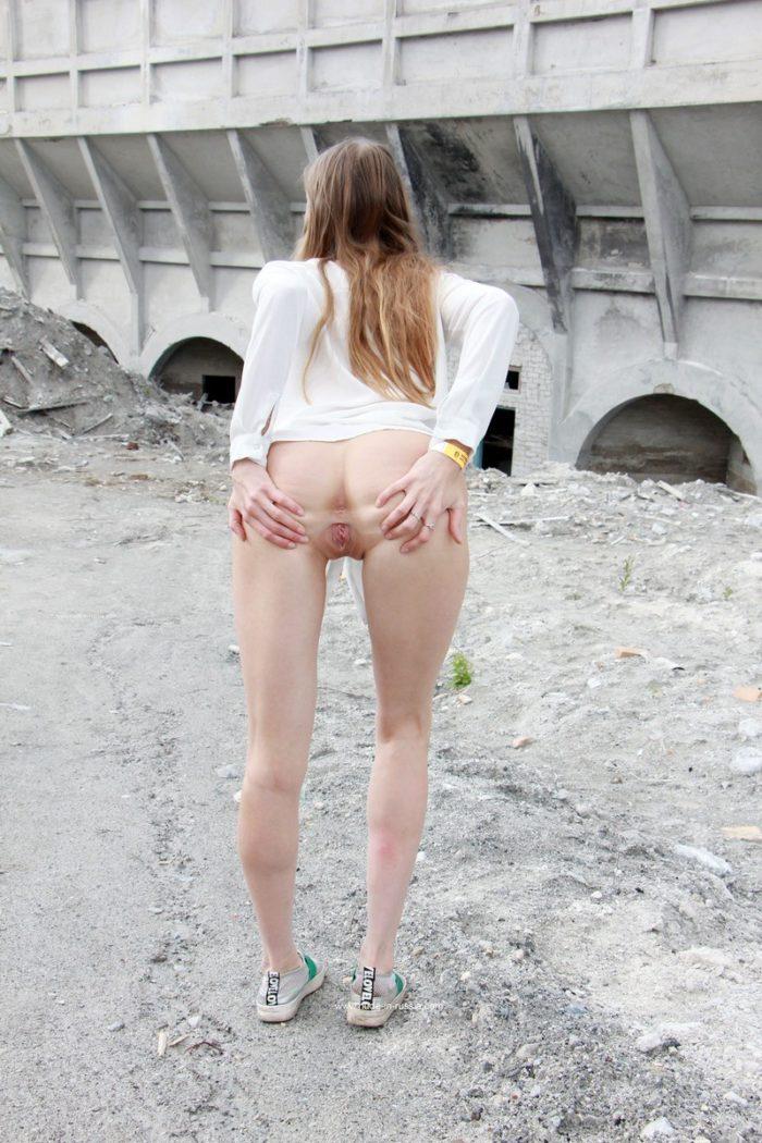 Slim blonde Nimfa posing naked at tourist place