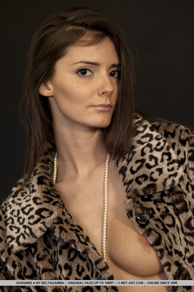Sunshine A looks stunning in her leopard coat and peep toe stilettos. Her breasts adorned in nothing but pearls.