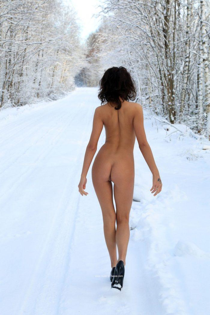 Super cute russian doll Nikola posing in sexy dress at winter road