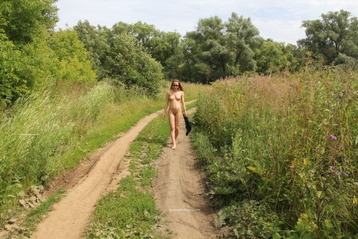 Sweet russian girl Abbey walks naked outdoors