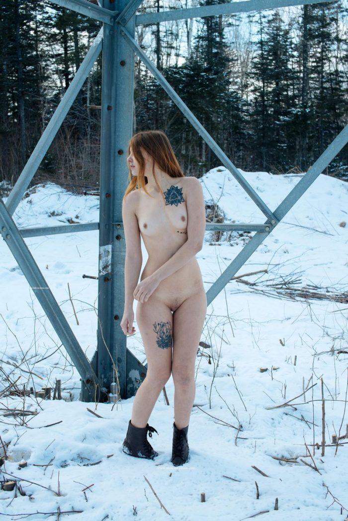 Tattooed Anna I posing under power lines
