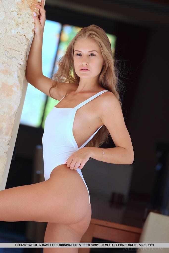 Tiffany Tatum displays her petite body and sweet asshole as she strips her bikini.