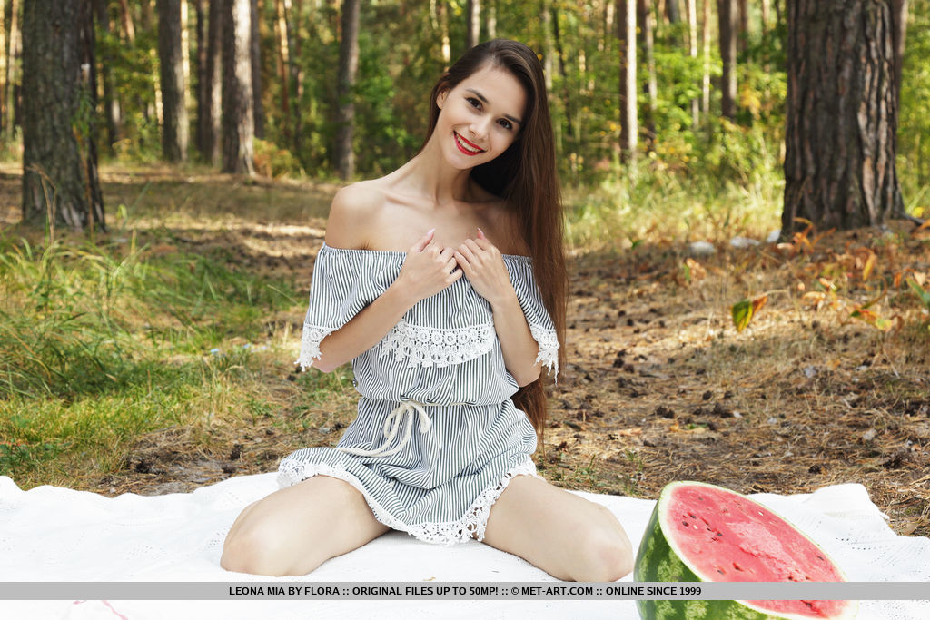 Top model Leona Mia bares her petite body and pink pussy as she eats her watermelon.