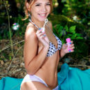 Youthful Alicia Love strips outdoors as she plays with bubbles.