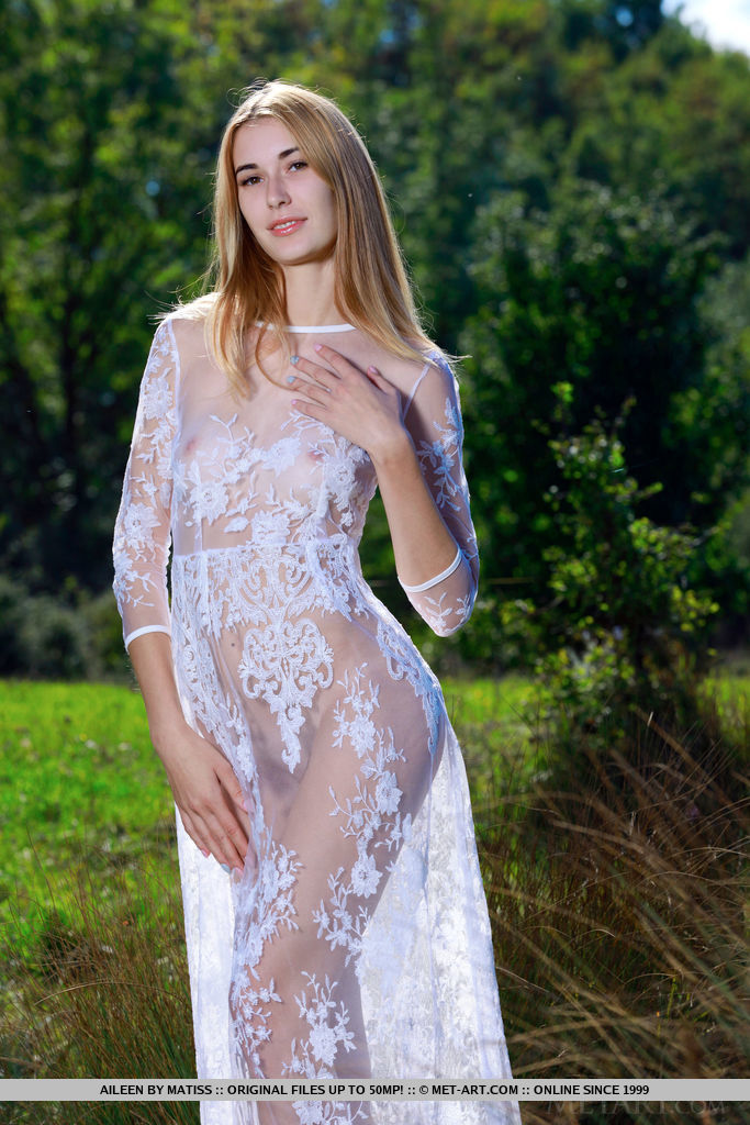 Aileen slowly removes her beautiful white dress as she reveals her slender, tanned body.