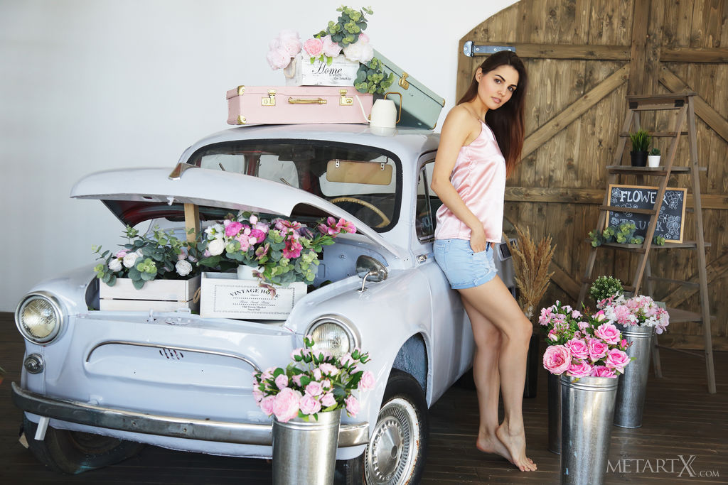 Alise Moreno shows off her gorgeous body as she poses beside a vintage car