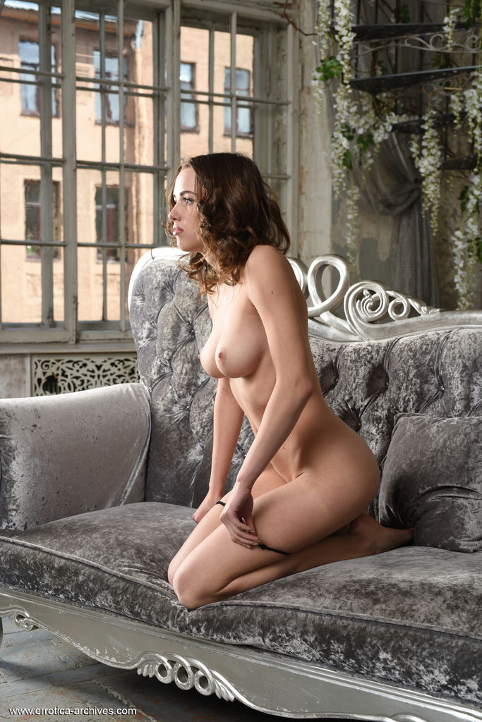 Alluring Maxa flaunts her amazing body as she sensually strips on the sofa.