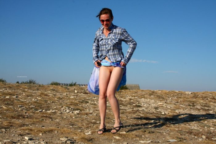 Almost naked Asja K on top of a hill