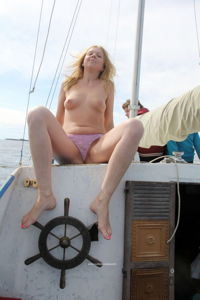 Blonde Jana M spreads legs on boat