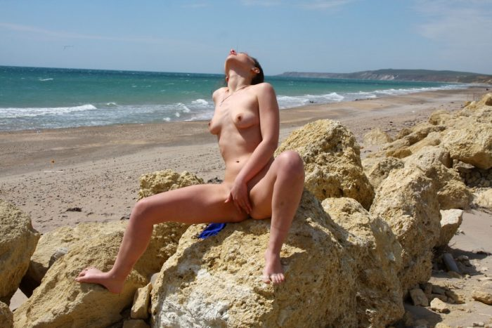 Hot Alisha touches her pussy at windy beach