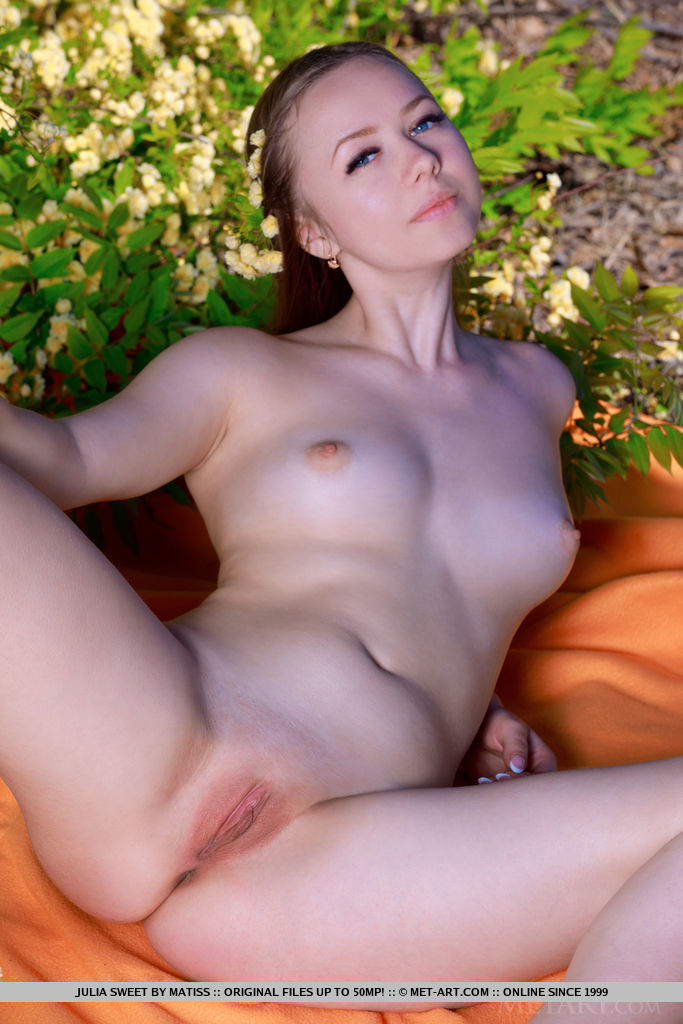 Julia Sweet sensually strips in the garden baring her sweet, yummy body.