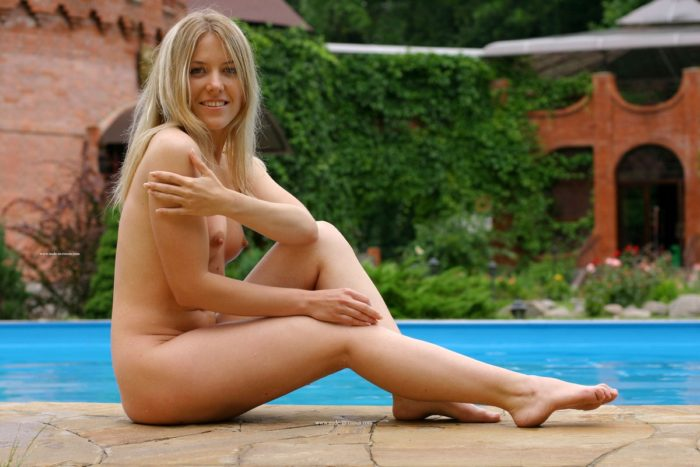Lovely blonde Oxana G posing at pool