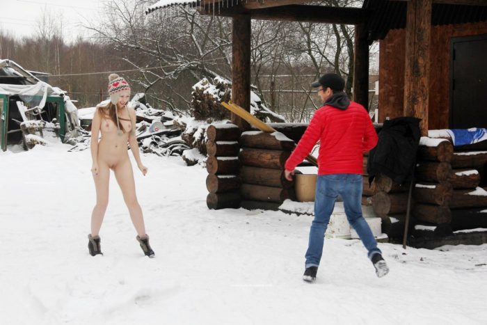 Naked Angelika plays with snow