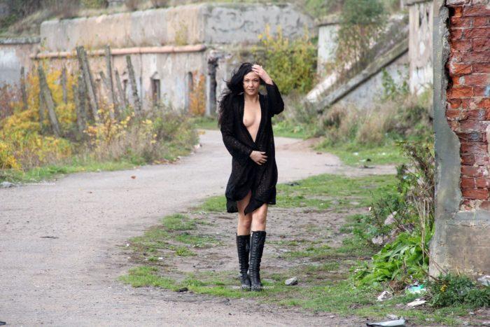 Naked brunette Masha S posing at public place
