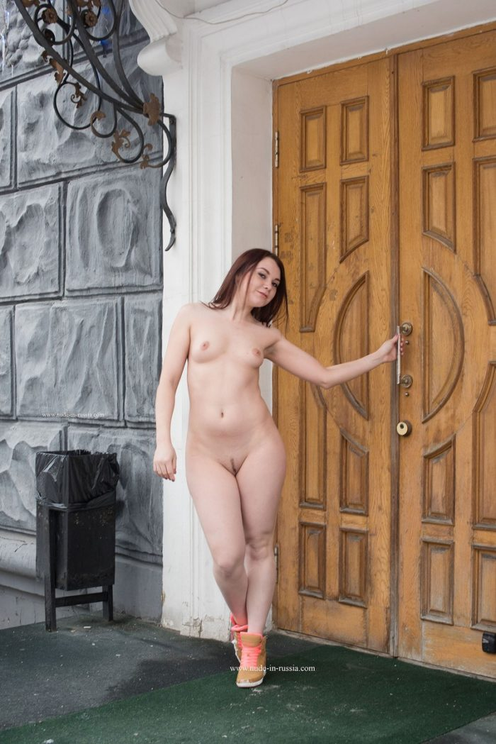 Naked girl on the snowy city streets