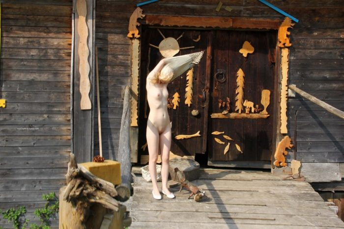 Russian blonde Maria walks naked at village