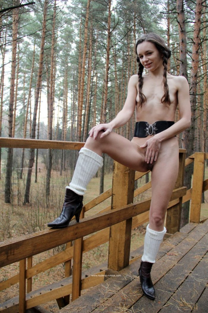 Russian girl with skinny body and hairy pussy posing in forest