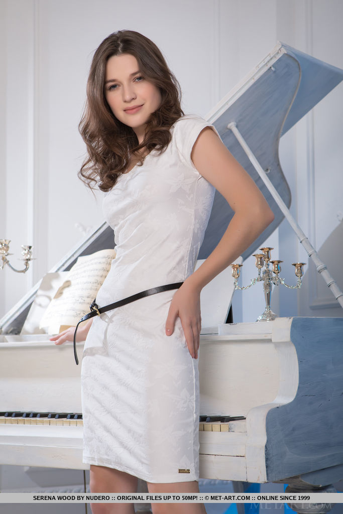 Serena Wood erotically strips her white dress as she shows off her delectable body by the piano.