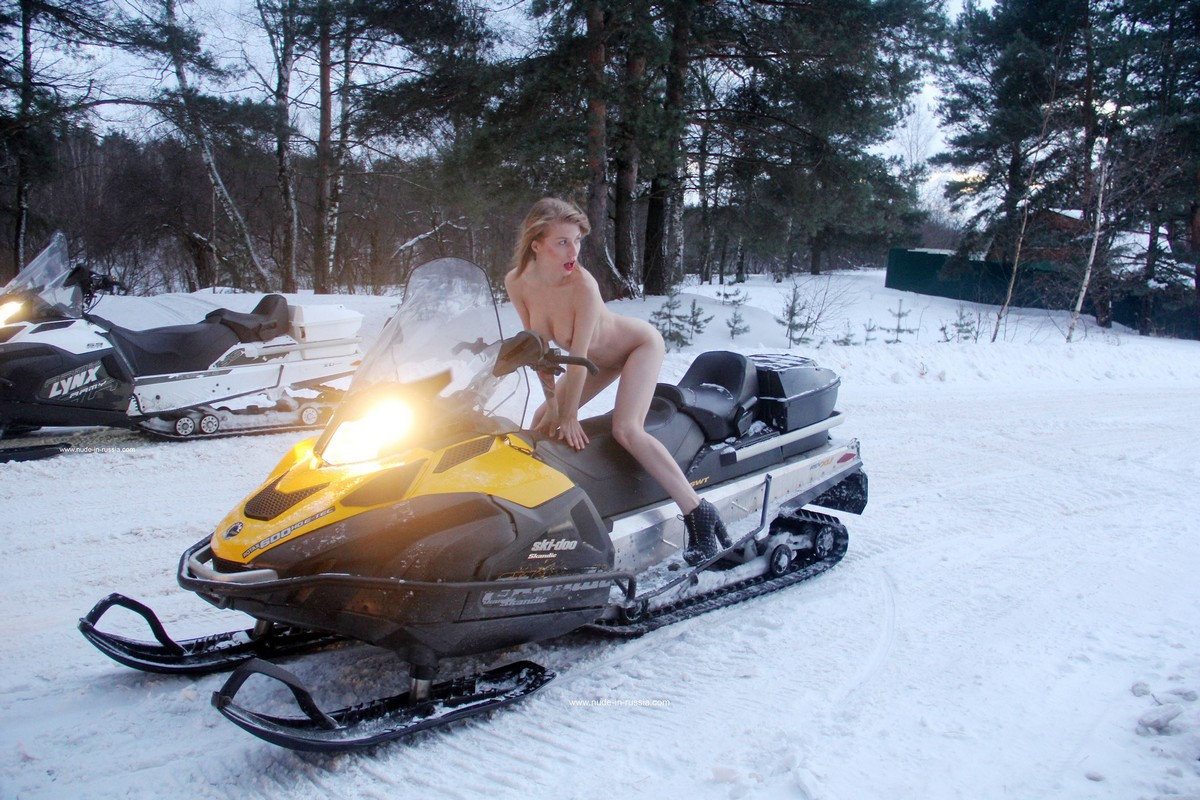 Inside sexy babes on snowmobiles