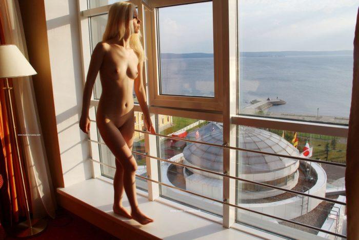 Sweet russian girl masturbates on windowsill
