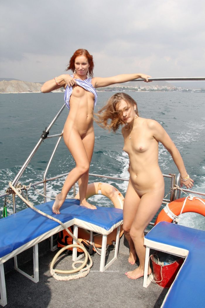 Two young girls posing on the boat