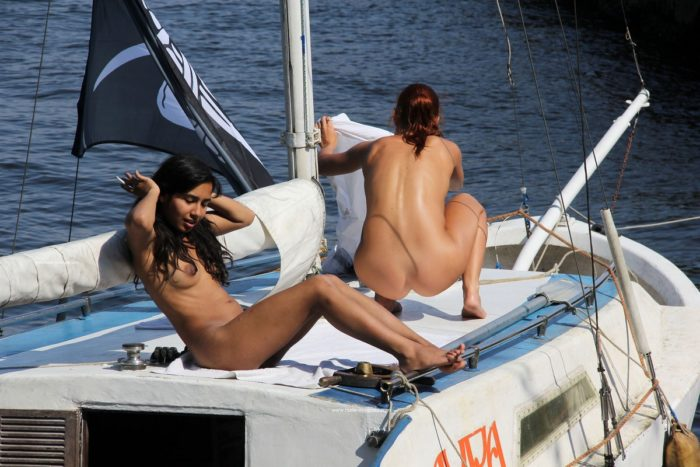 Young girls relaxing on boat with no clothes