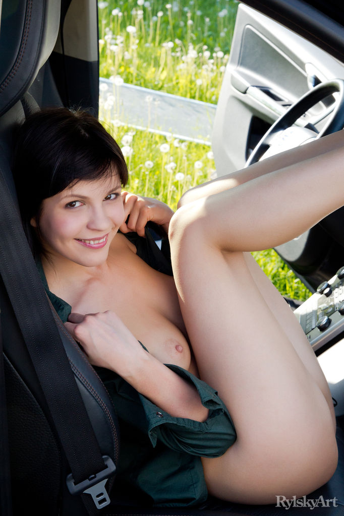 Zelda might look shy and innocent, but she exposes all of her smooth, sexy body as she plays naked in the car.