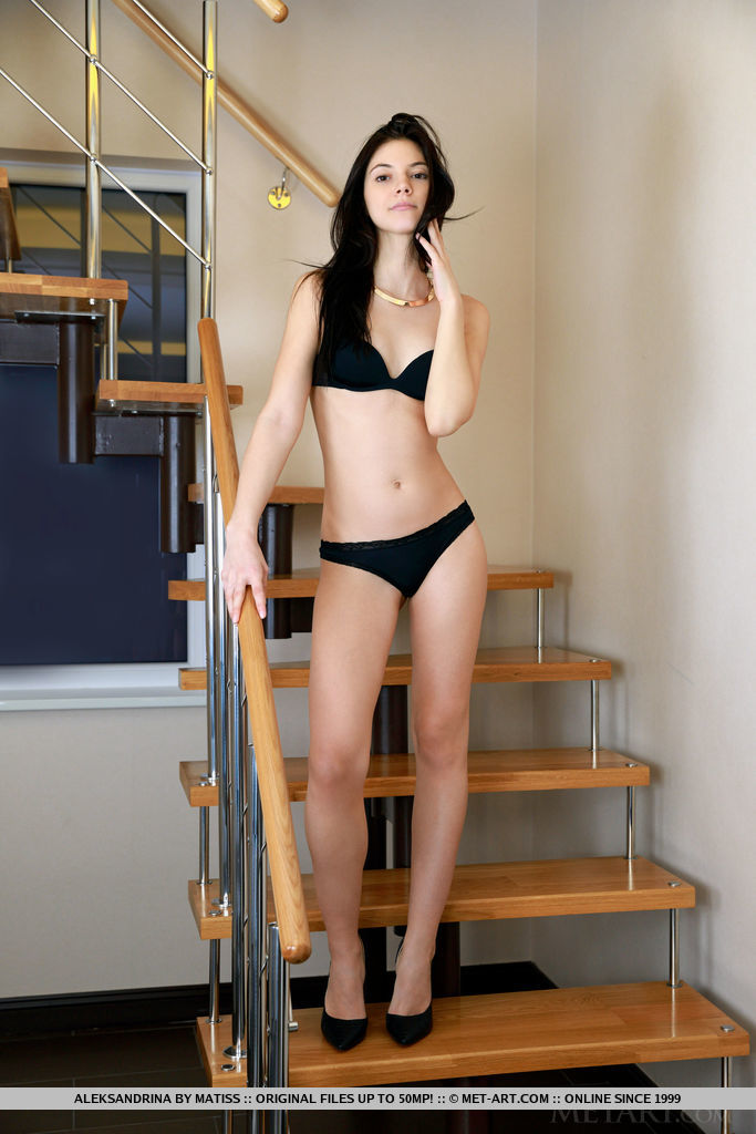Aleksandrina sensually strips on the stairs as she bares her slender body.