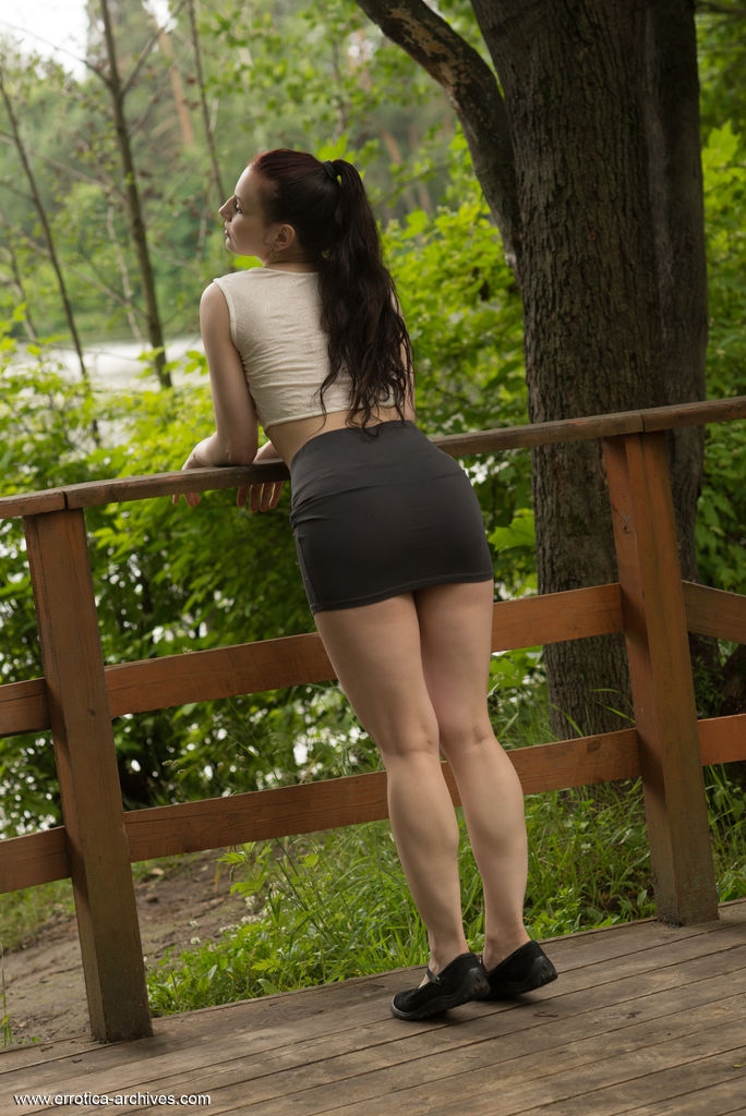 Lisa Musa shows off her sexy, tight body as she playfully poses on the wooden bridge.