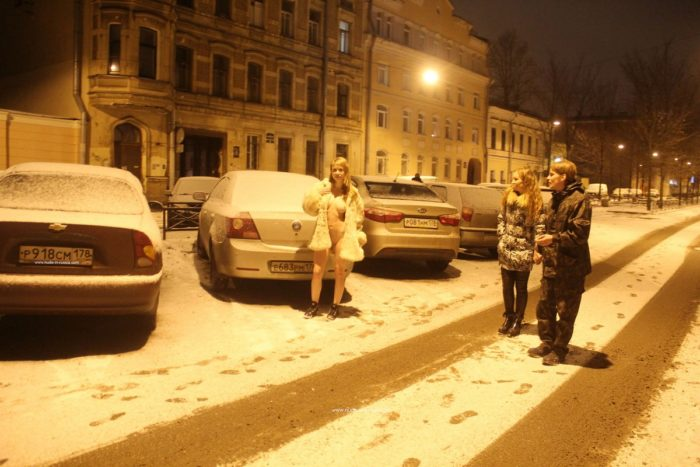 Naked blonde at winter streets