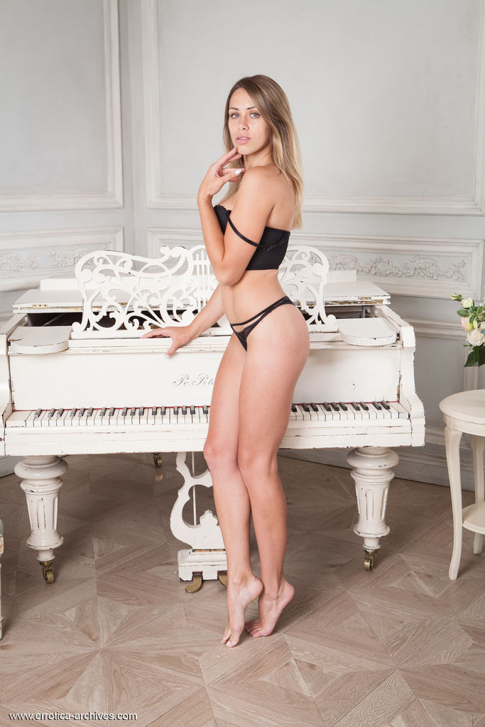 Tanya Fay strips her black lingerie as she bares her smoking hot body.
