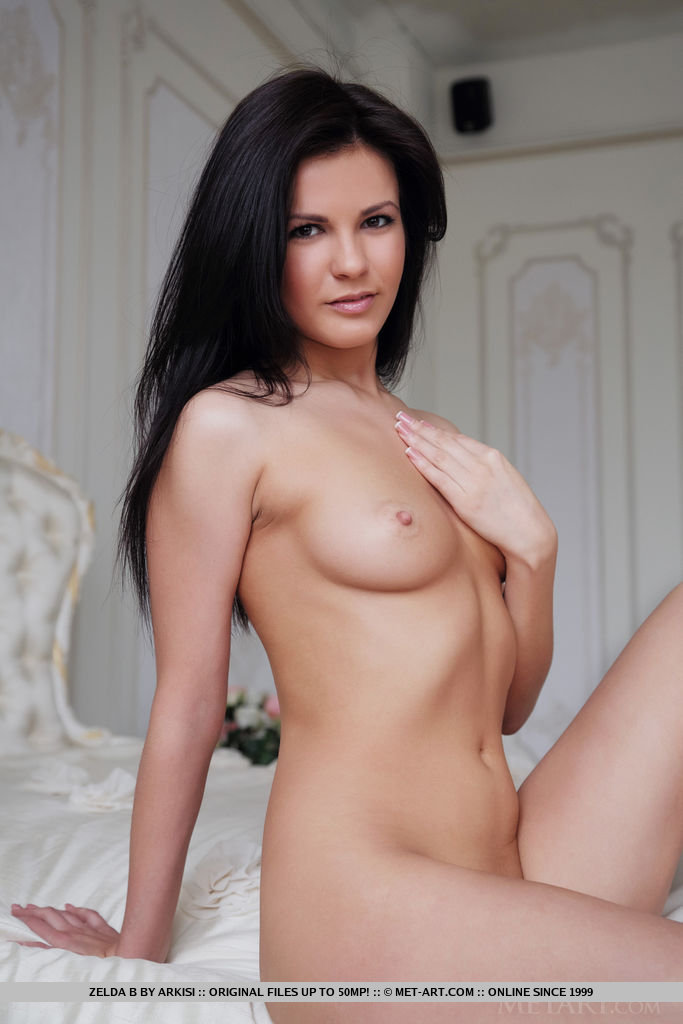 Zelda B takes off her clothes and shows off her naked body