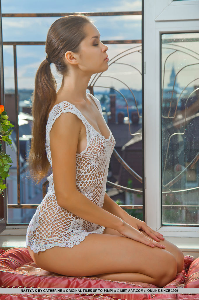 Adorable Nastya K posing in white knitted top