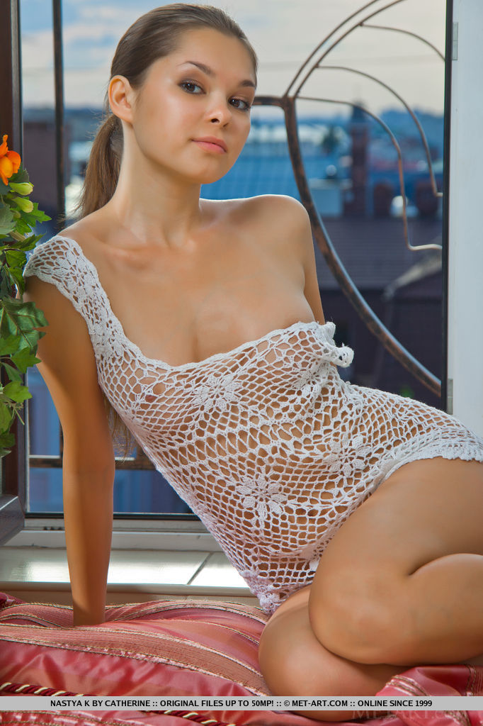 Adorable Nastya K posing in white knitted top