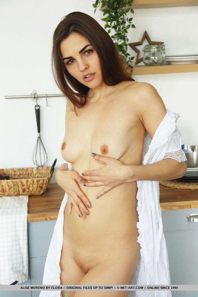 Alise Moreno bares her slender body and sweet pussy as eats her breakfast.