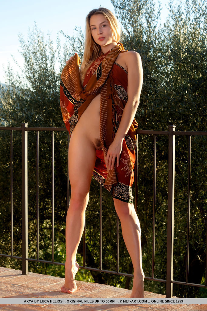 Arya displays her tight body with small perky tits as she poses on the veranda.