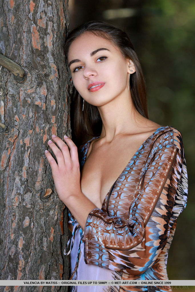 Beautiful Valencia bares her sexy, tight body as she strips in the forest.