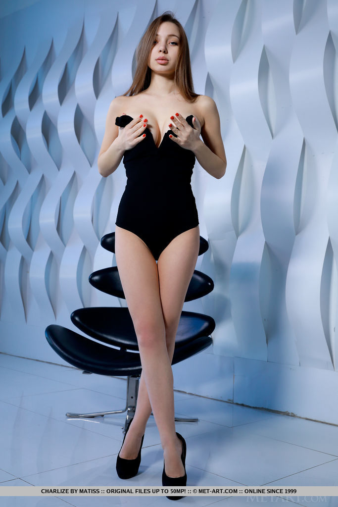 Charlize strips her black corset, baring her gorgeous body.