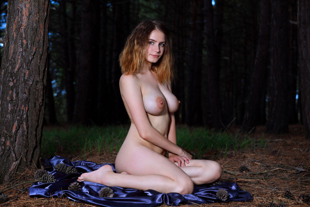 Dakota Pink poses on her white lace bodysuit before getting naked to caress her body