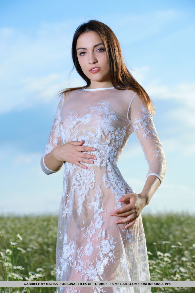 Gabriele strips her white dress baring her sexy, slender body outdoors.