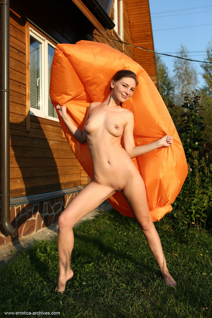 Galina A flaunts her sexy curves as she playfully poses in the backyard.