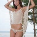 Irina J enjoys being nude in her hammock