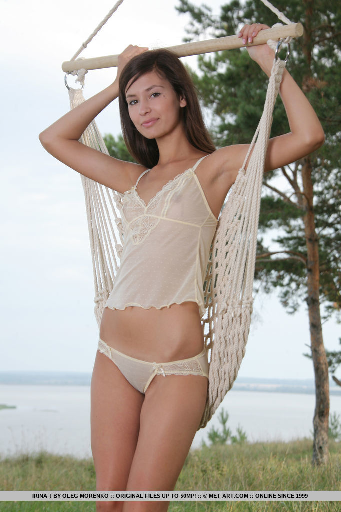 Irina J enjoys being nude in her hammock